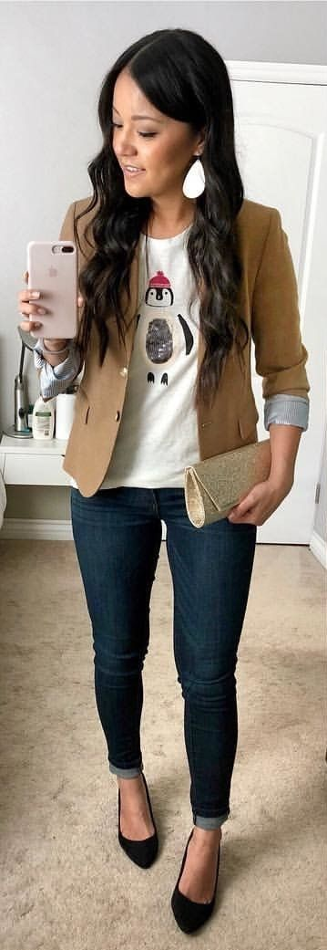 #winter #outfits women's white penguin printed shirt, brown blazer, and blue denim jeans outfit. Click To Shop This Look.