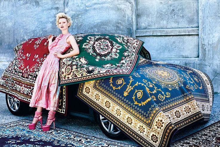 Posing with rugs, Mia Wasikowska wears pink Chanel dress and pink Gucci platform heels