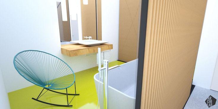 Rodičovská kúpeľňa s voľne stojacou vaňou a perforovanou stenou z drevených fošní je vizuálne prepojená so spálňou. Zaujímavý kontrast vytvára liata polyuretánová podlaha. Interiér mezonetového bytu - Mýtna, Bratislava - Interiérový dizajn / Bathroom interior by Archilab