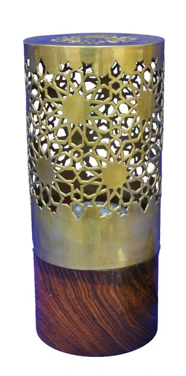 Brass Jali Lamp, India: This led lamp is made from a hardwood base and brass lamp shade. The jali (ornamental latticed screen traditionally used in architecture in India) design of the brass is reminiscent of Delhi & Agra. The International 2012 Panel of Experts commended the good design balancing the decorated and plain sections of the lamp. The jali, latticed design, on the top of the lamp creatively reveals patterned shadows.