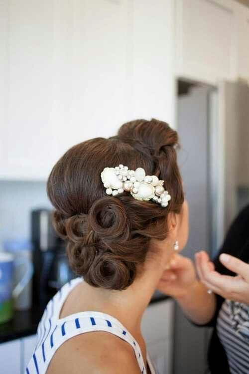 Elegant pinned up hair .