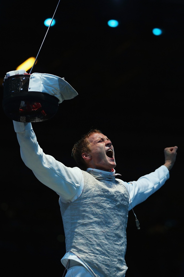 Artur Akhmatkhuzin of Russia celebrates after beating Richard Kruse of Great Britain during the round of 32 Men's Foil Individual on Day 4 of the London 2012 Olympic Games at ExCeL on July 31, 2012 in London, England.    Photo by: Hannah Johnston/Getty Images