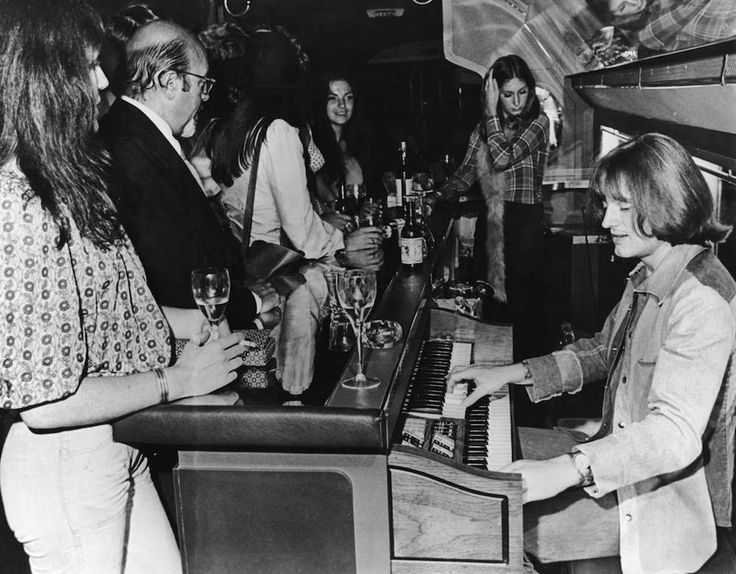 John Paul Jones of English rock group Led Zeppelin plays a Thomas electric organ behind the bar on board a private Boeing 720B airliner known as The Starship which is being used by the band on their North American tour 30th July 1973. http://ift.tt/2f4xk7s