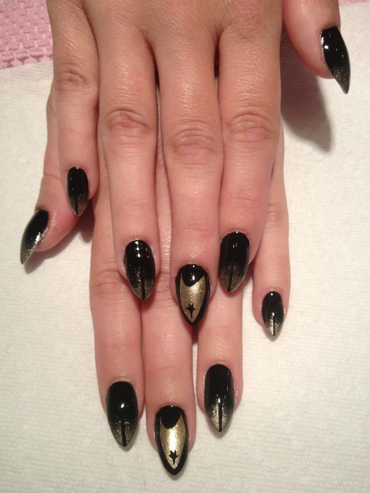 Star Trek black and gold insignia nails by user mookienotsnookie on reddit.