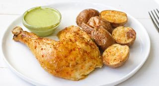 Peruvian Chicken with Green Chile Sauce : Recreate restaurant-worthy Peruvian Roasted Chicken at home, with the help of pure flavor, including a robust blend of oregano, cumin and smoked paprika. A traditional green chile dipping sauce adds creamy heat to crispy, savory chicken. Serve with roasted baby potatoes and fresh lime for a new from-scratch favorite.