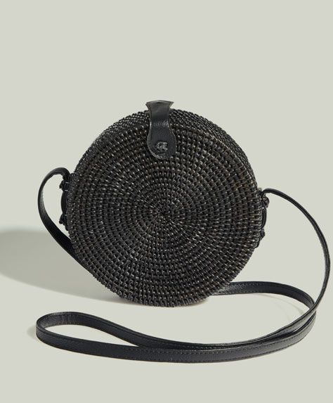 Round bag, 29.99£ - Round black bag with a crossbody strap detail. - Find more trends in women fashion at Oysho .