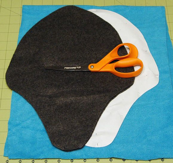 This is a fun and practical hat. With ear flaps it will keep the wearer warm on even the windiest day.
