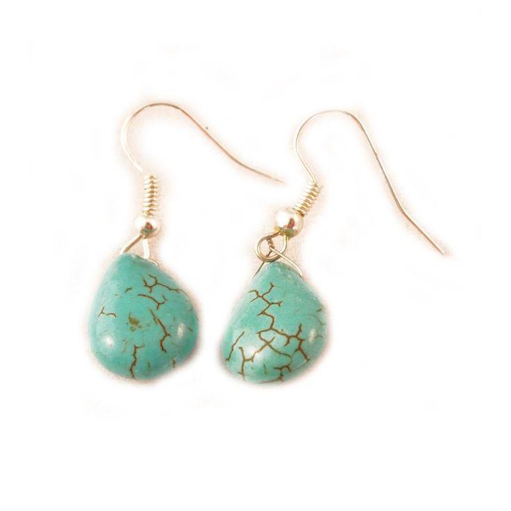 Handgemaakte zilveren oorbellen met turquoise steen