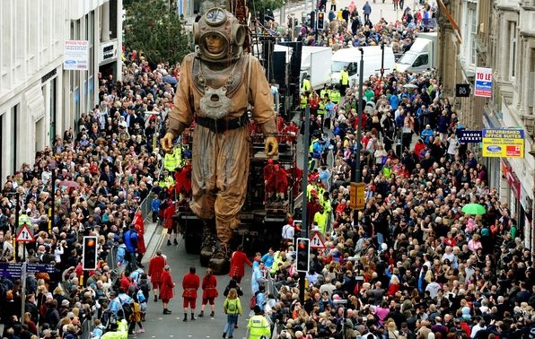 Giant Uncle moves through the crowds lining Castle Street as part of the Sea Odyssey