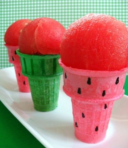 Simply use edible markers to draw little watermelon seeds and rind on colored ice cream cones and top with a big ice cream scoop of watermelon. No, not ice cream, just watermelon! Super easy, super cute. Great way for kids to eat their fruit!
