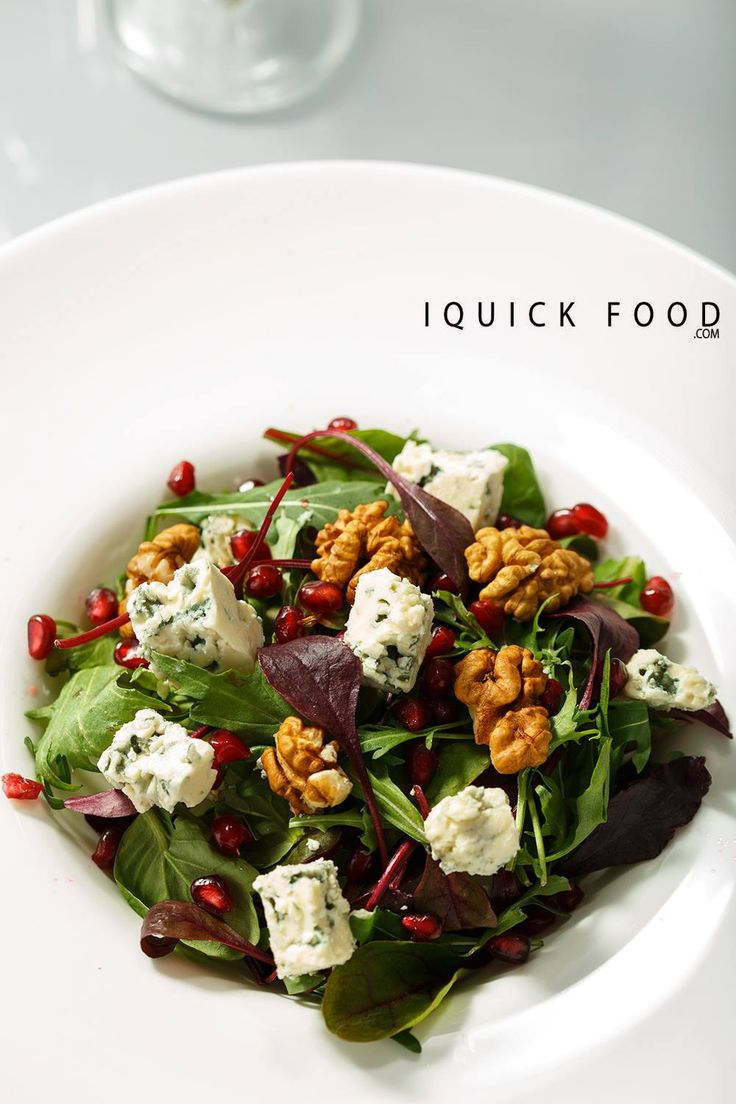 Pear blue cheese salad with walnuts and pomegranates is a fresh combination of pop in your mouth flavors and textures. #salad #bluecheese #pomegranate #walnuts