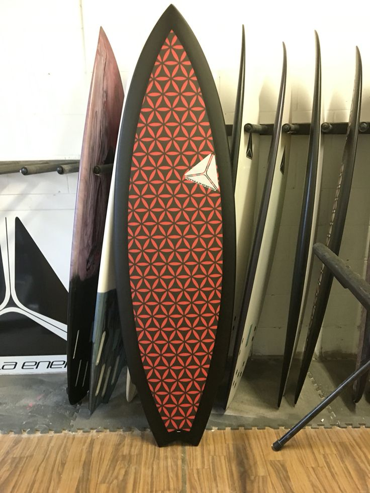 Custom USC Mutant with red and black inverted flower if life design by Formula Energy Surfboards.