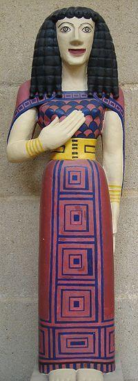 KORA Z AUXERRE  Kora z Auxerre (Dama z Auxerre) to wykonana prawdopodobnie na Krecie figurka z piaskowca pochodząca z 650-625 pne (okres wczesnoarchaiczny)