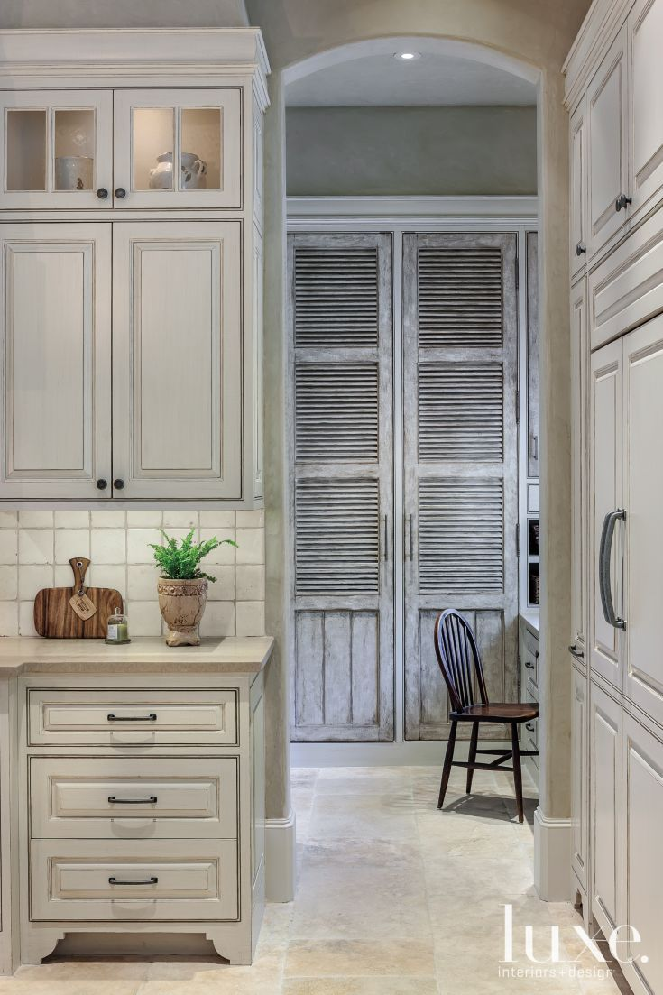 64 best tile images on pinterest bathroom ideas bathrooms decor an arched doorway off the kitchen lends a glimpse into a pantry and office space dailygadgetfo Image collections