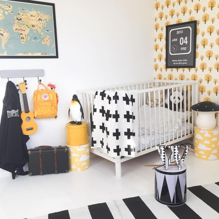 Black, white, and yellow kids room with Ferm Living Dottie wallpaper