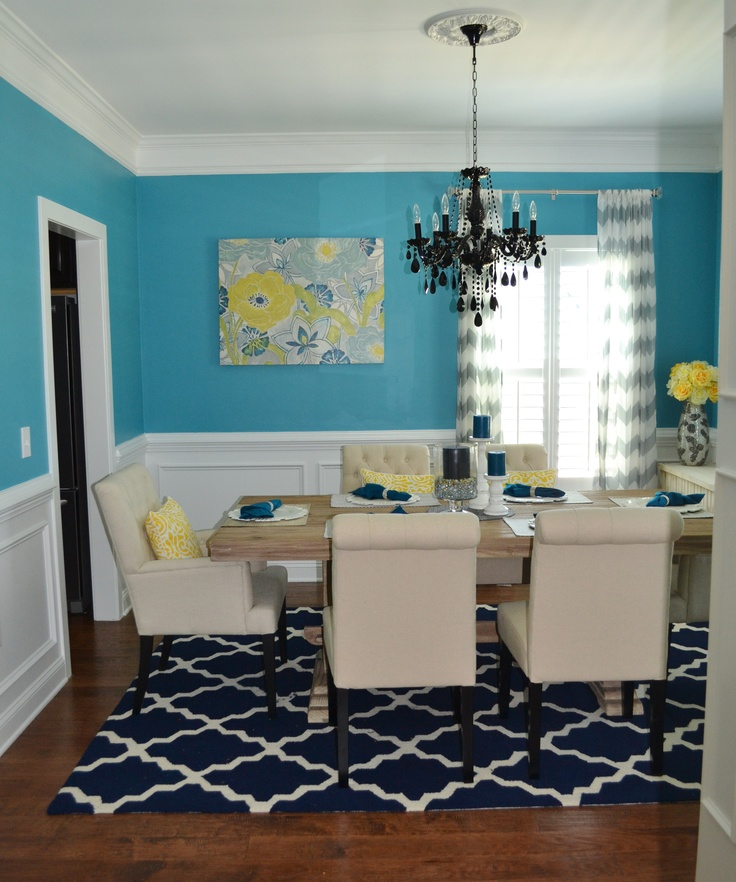 Turquoise and yellow dining room with black chandelier for Yellow dining room ideas