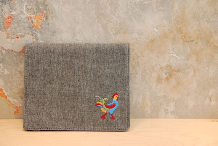 mini ipad case by 'white tales'. Made from natural cotton fabric and have embroideries inspired by Greek traditional costumes.