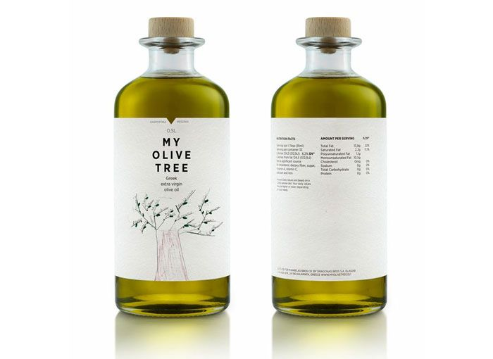 botella de vidrio de diseño transparente con tapón de madera y etiqueta de papel con ilustración de olivo