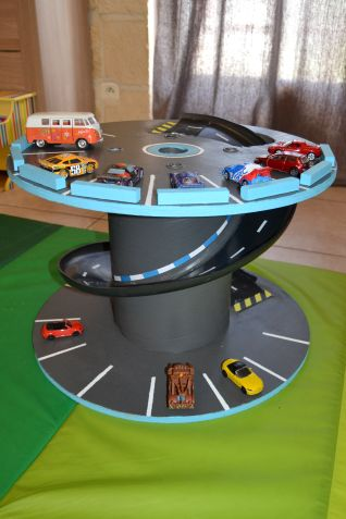 Turn a Spool into a Toy Garage...these are awesome ideas!