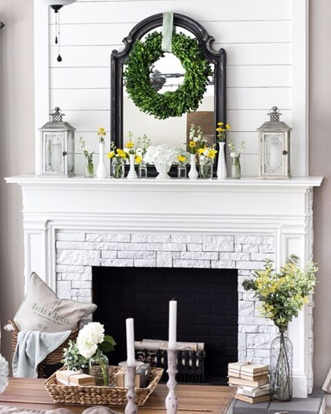 all white fireplace and mantle. Shiplap fireplace. magnolia wreath and decor / Hygge home decor