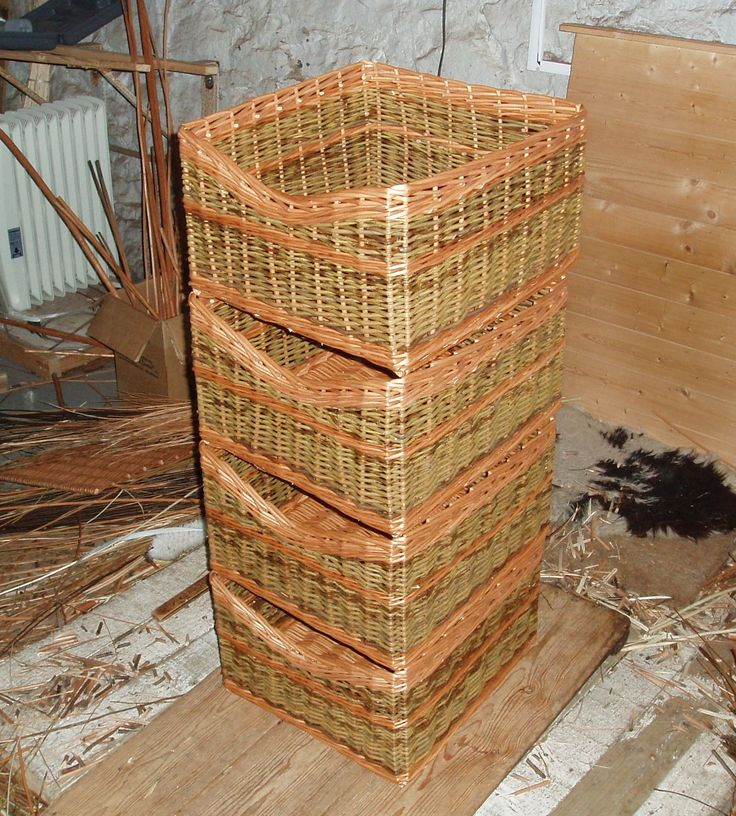 The full set of 4 storage baskets in buff and green willow with dipped front.