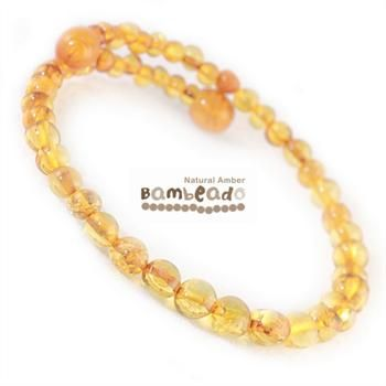 This amber bracelet is made from round baltic amber in a honey colour. The bracelet is made from memory wire that retains it's shape when coiled around your wrist (a little like a slinky!). There is no need to fiddle with a clasp.While Bambeado amber comes in several colours, the colour is just a matter of personal choice. The colours may vary slightly from the images on the website due to variations in the amber beads. Each amber bracelet is unique.