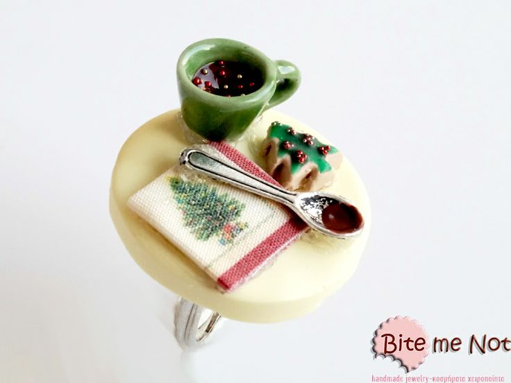 ''Hot chocolate,christmas cookie & napkin on a table''Ring!