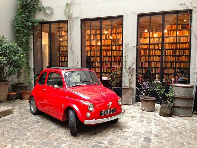 Exterior of Merci concept store in Paris.  Black casement windows with white exterior.