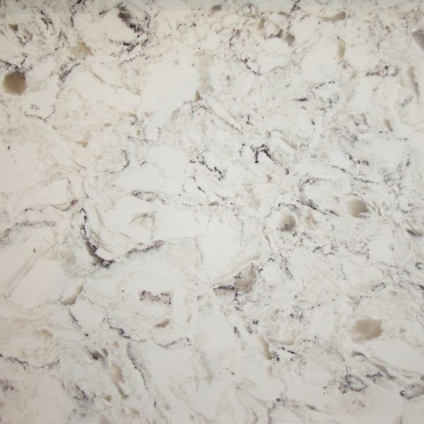 This is the radiant Bianco Foresta. It is new this year 2017 which is classed as a jumbo slab so it can be used for much larger areas for the perfect kitchen island. It is a white background with multi coloured marbeling throughout. A lovely natural appearance.