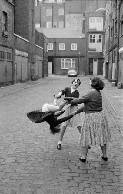 Girls playing, c.1956 by Oscar van Alphen. | city vintage | children | playing | playful cobble stone | court yard