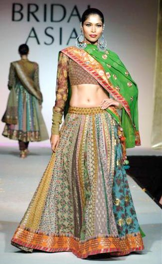 Sabyasachi Mukherjee- Sabyasachi Bride - Green lengha - Sangeet outfit inspiration - statement earrings #thecrimsonbride