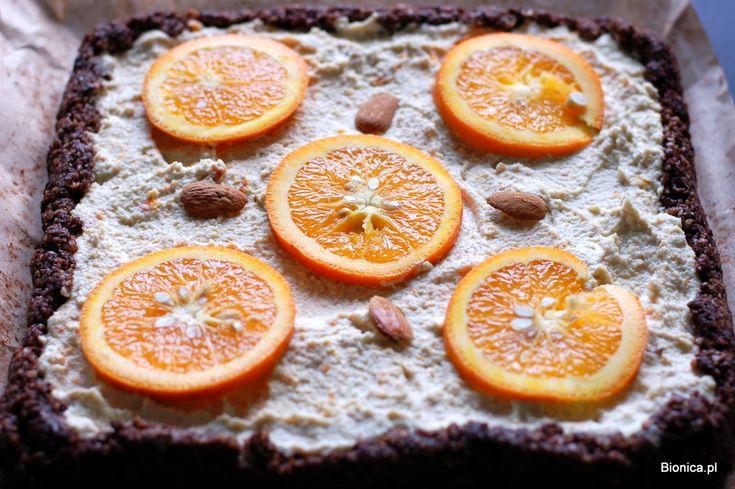 raw nuts orange cake with some cocoa; bottom: almonds, pumpkin seeds, dates, cocoa; top: cashews, orange peel