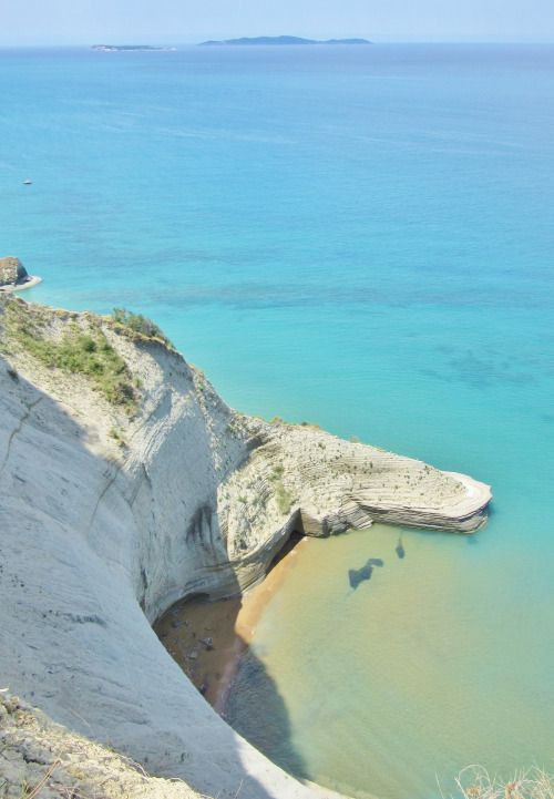 Hidden beach under sandstone cliffs in Sidari, Corfu, Greece