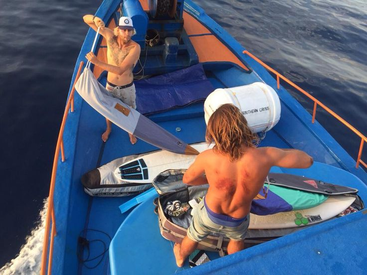 The boys in the mentawai, making sure their surf board is put into the board cover bag! The surf sock is a good way to prevent your board from dings and scratches! More on www.rosesdesvents.com