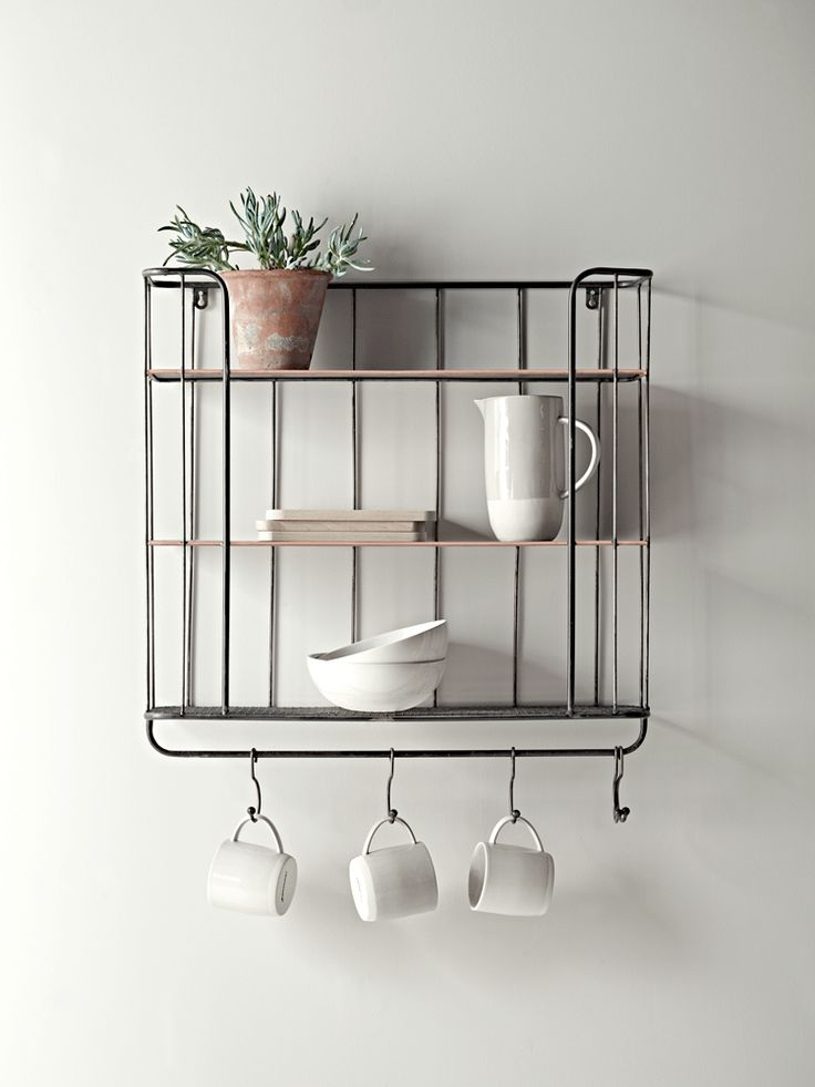Please note this product is currently out of stock. This shelf will be returning to stock in June. Please enter your email address below to receive an instock email notification. Store your essentials in style with our clever shelf unit. Inspired by the industrial trend, each rustic metal shelf has two solid shelves with copper edge detail and one bottom mesh shelf, plus five hooks for hanging, making it ideal for storing your mugs and dinnerware.