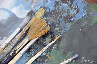 Set of bristles over paint smudges
