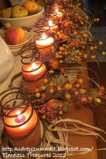 Beautiful for a mantel display.  Made from rusty springs, candles and other fall colors.