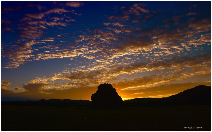 Sunset behind a sacred rock, Mongolia by Erawan BrokenTale