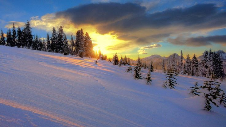 cool snowy hills in the sunset