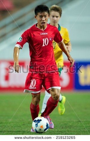 NONTHABURI THAILAND-SEPTEMBER 17:Choe Song Hyok no.10 of DPR Korea for the ball during the AFC U-16 Championship between Australia and DPR Korea at  Rajamangala Stadium on Sep17,2014,Thailand