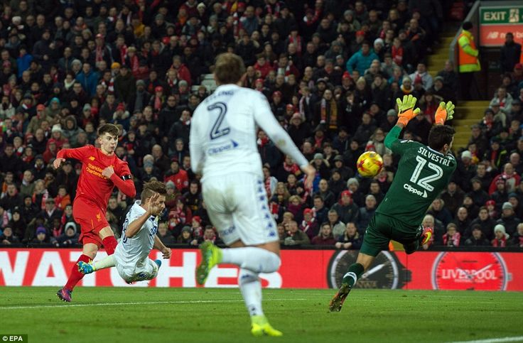 Leeds goalkeeper Marco Silvestri is unable to turn away Woodburn's powerful shot in the closing stages of the game