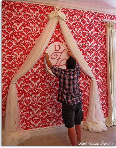 Great feature wall behind crib in baby's room - love the draped tulle for a faux curtain look.