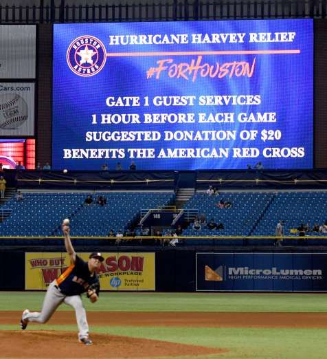 Houston Astros ask fans for donations to the American Red Cross for Hurricane Harvey Relief during their game against the Texas Rangers at Tropicana Field on August 29, 2017 in St. Petersburg, Florida.