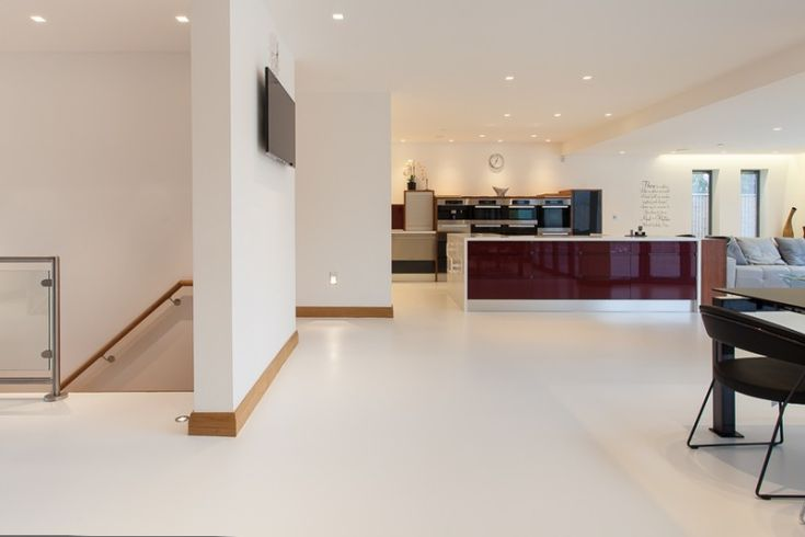 Poured resin floors throughout this family home... LuxSphere in Solid White