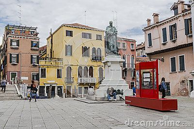 One of the many squares with monument and tourists in Venice , Italy. Europe .