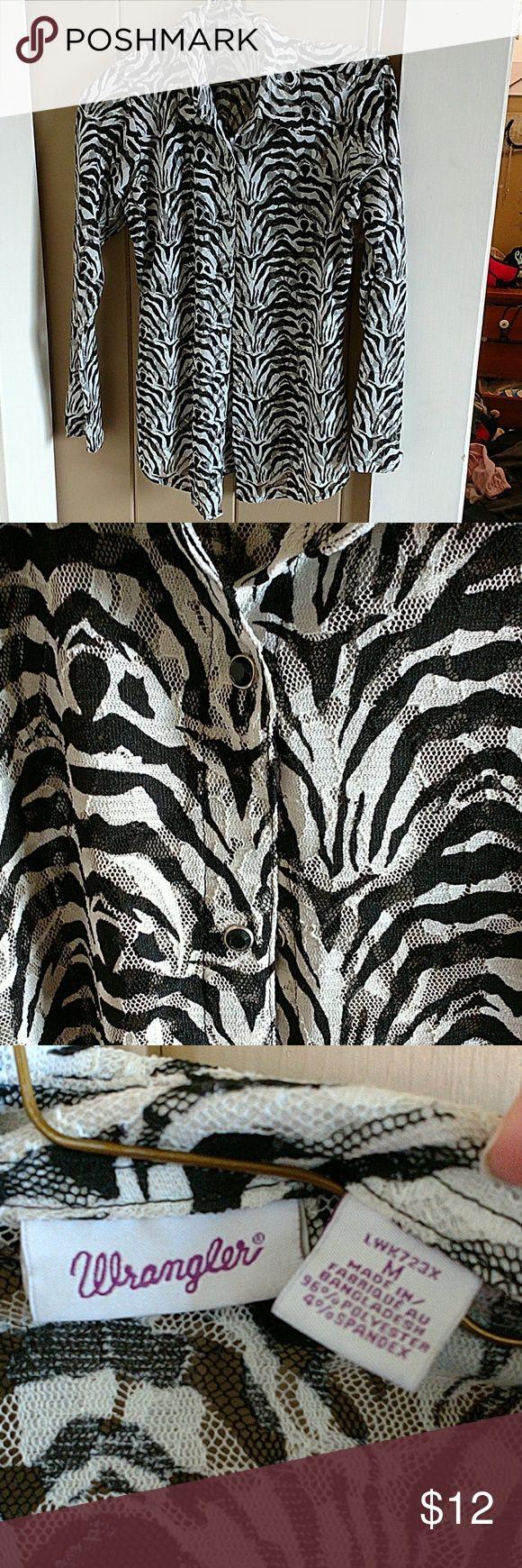 Cute zebra print button down Wrangler shirt! Super cute button down shirt I've actually never worn!! Feel free to make an offer. Wrangler Tops Button Down Shirts
