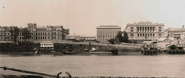 Queen's Wharf in Brisbane from the south side of the river.The 1910-1927 morgue is the pale coloured building below Queen's Wharf Road. The sub-floor supports of this building remain in this location today. State Library of Queensland.