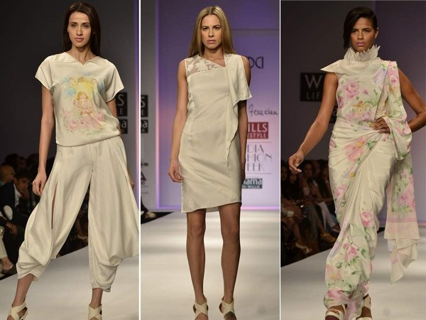 James Ferreira: He is known for 'wearable couture' and his collection at WIFW stands true to that. What made our heads turn was the lovely pink flowery patterns on that white satin sari! The top (left) is inspired by baby Ganesha frolicking with cherubs in a rose garden by the lotus pond, and looks perfect with those harem pants.