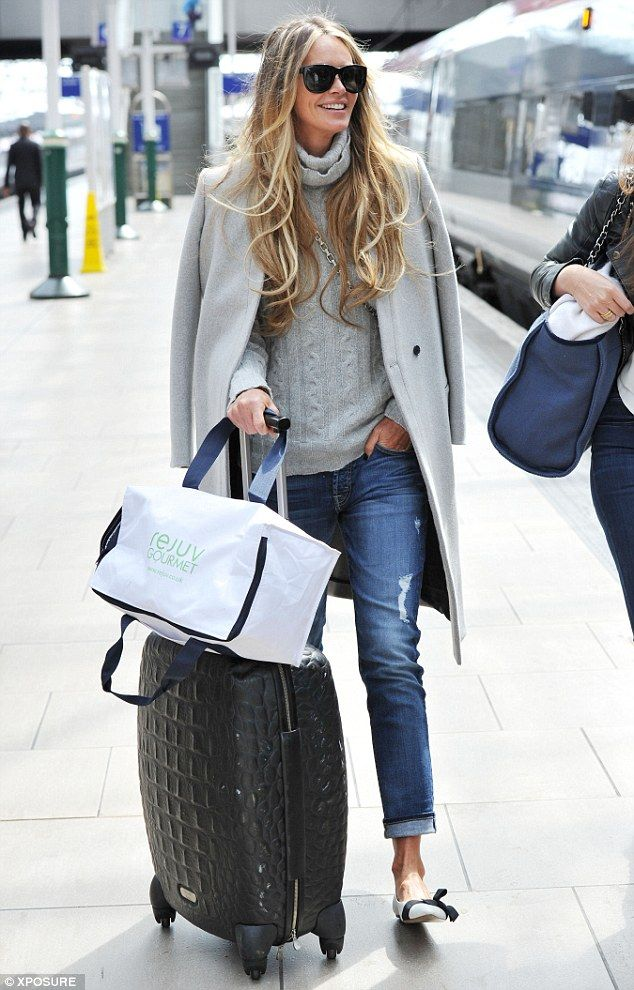Here she comes: Elle Macpherson makes her way across Manchester Piccadilly train station on Friday