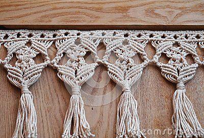 Background with beige cotton tassels